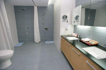 奥运村运动员公寓楼室内装修按区域大致分为四种设计
