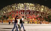组图:中国田径公开赛首日 夜色映衬下鸟巢