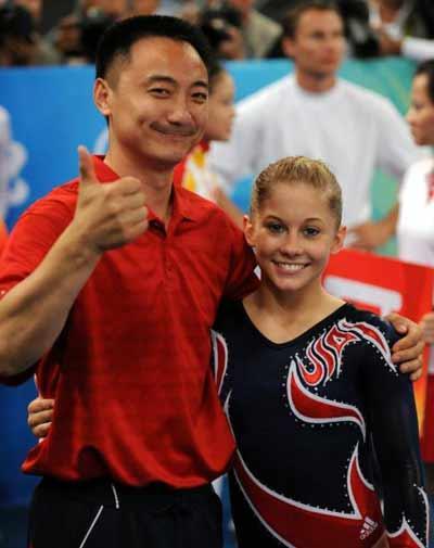 奥运冠军肖恩 约翰逊与中国男人乔良的微笑